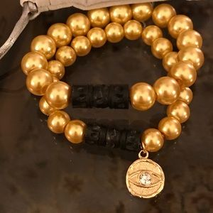 Jewelry - Beautiful gold pearl stack set of two.